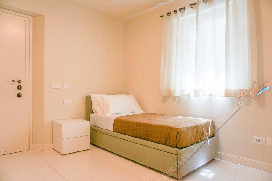 Villa Sweet : спальня с односпальной кроватью