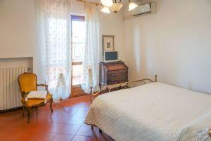 Villa Adelia : спальня с двуспальной кроватью