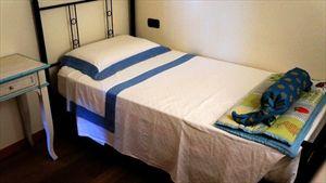 Villa Mandarina : спальня с односпальной кроватью