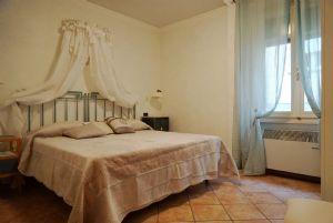 Appartamento Ferdinando : спальня с двуспальной кроватью