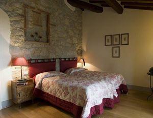 Tenuta Chianti Classico : спальня с двуспальной кроватью