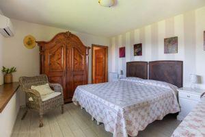 Villa Charme Toscana vista mare  : спальня с двуспальной кроватью
