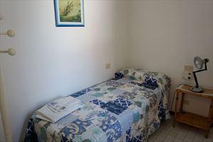 Appartamento Atlas : спальня с односпальной кроватью