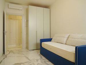 Appartamento Augusto : спальня с односпальной кроватью