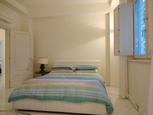 Appartamento Augusto : спальня с двуспальной кроватью