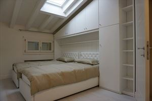 Appartamento Fiorenza : спальня с двумя кроватями