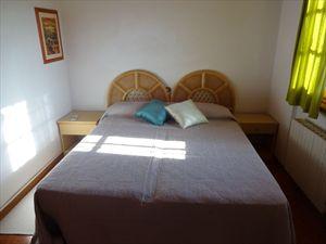 Villa Tranquilla : спальня с двуспальной кроватью