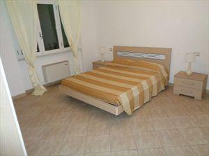 Appartamento Giardino : спальня с двуспальной кроватью
