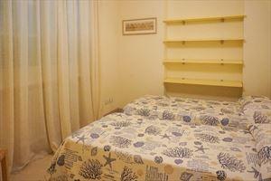Appartamento Arancione : спальня с двумя кроватями