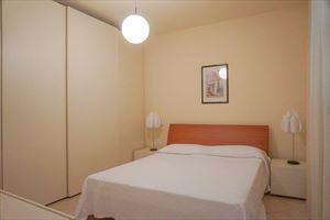 Appartamento Arancione : спальня с двуспальной кроватью
