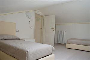 Villa Bianca : спальня с двумя кроватями