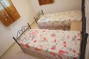 Villa Onda : спальня с двумя кроватями